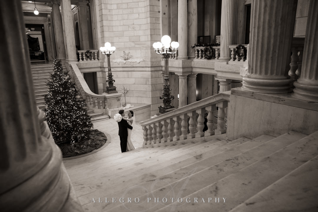 rhode island state house at christmas- Bride and groom embrace before wedding