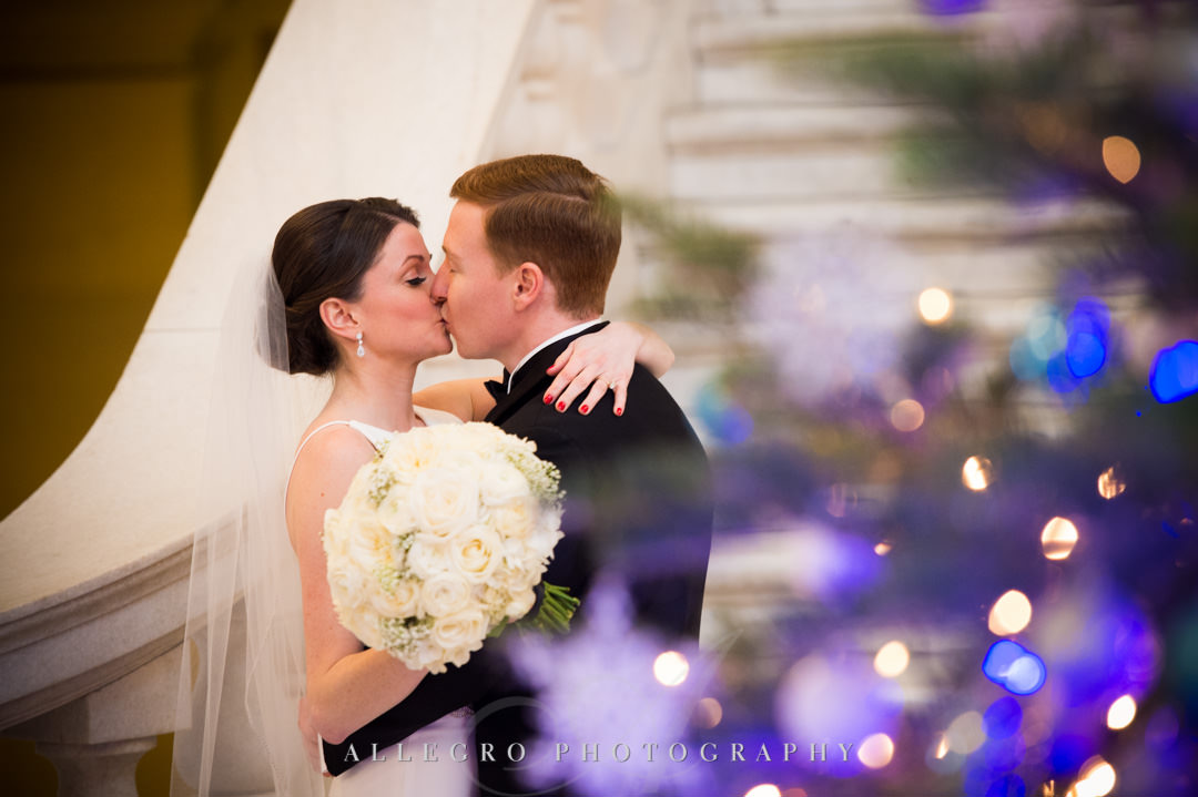 Bride and groom kiss before wedding