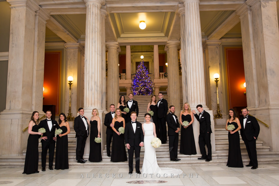 holiday wedding at the rhode island state house in providence- Bride and groom pose with their bridesmaids and groomsmen
