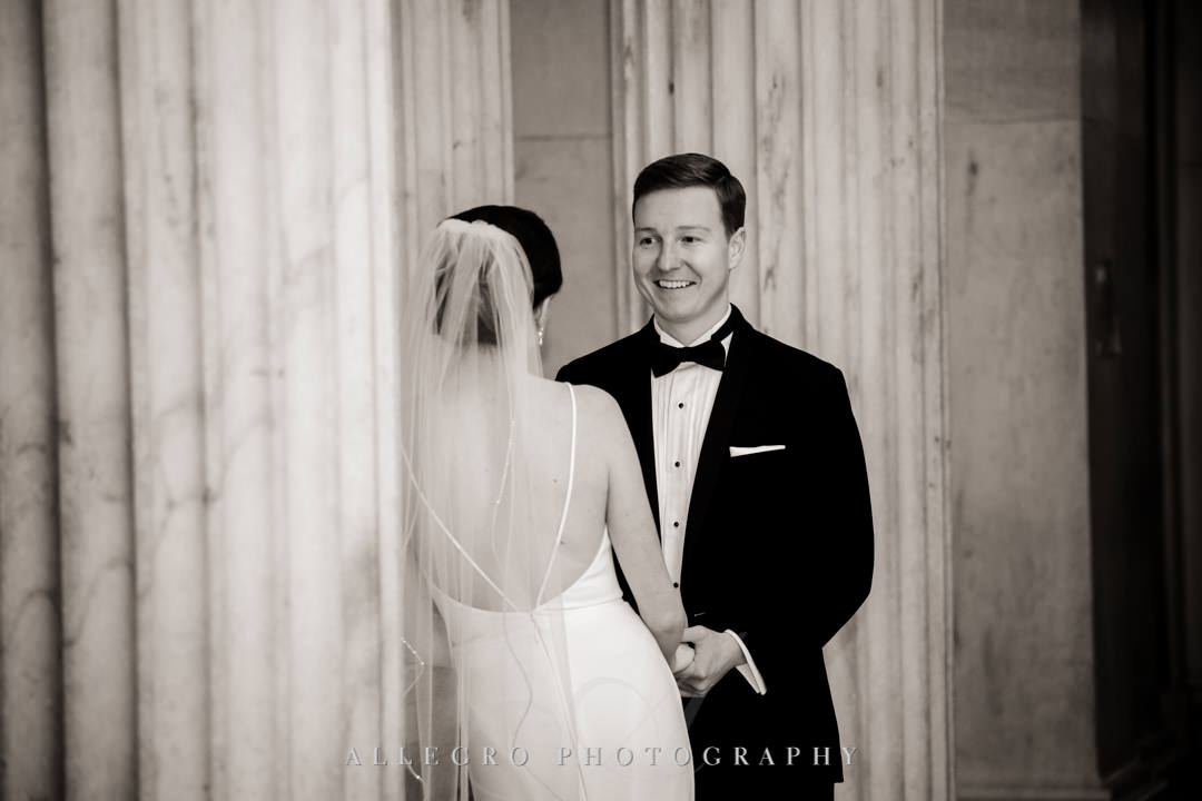 Bride and groom smile at each other before wedding