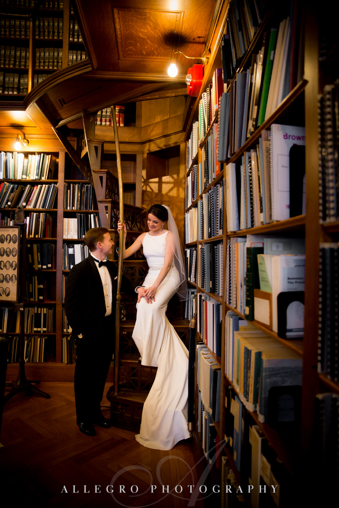 Bride and groom pose in library stacks of the rhode island state house, providence