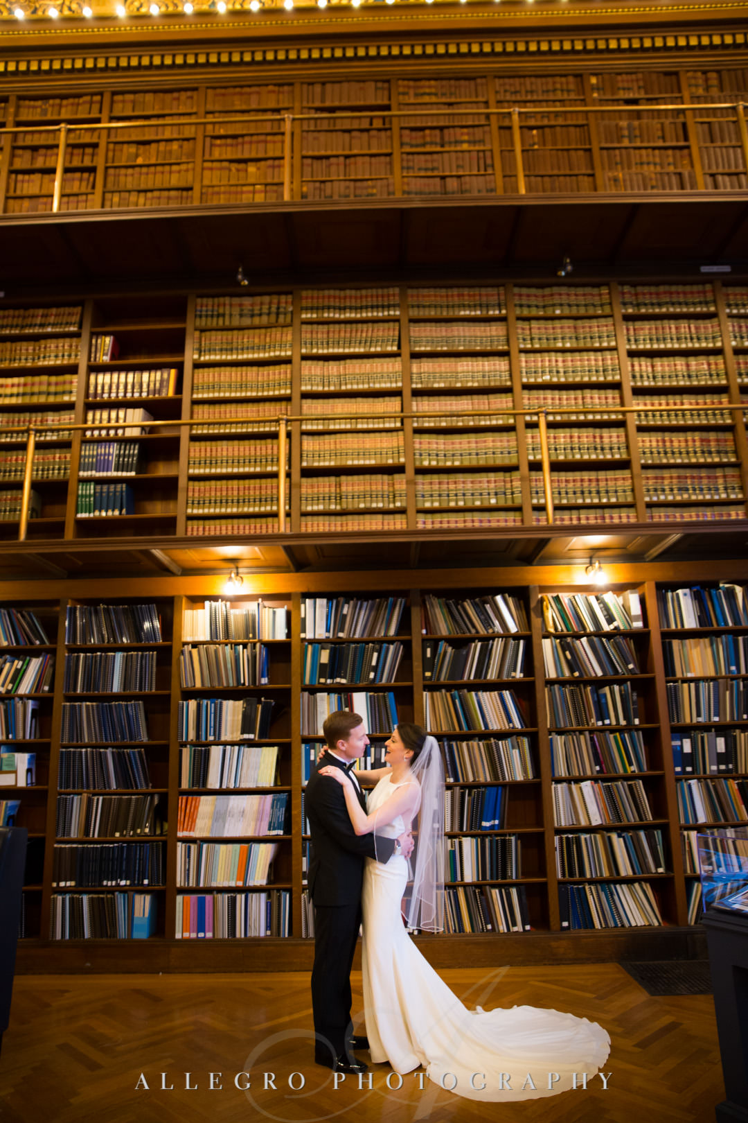 ri state house library- Bride and groom embrace in library stacks- rhode island state house