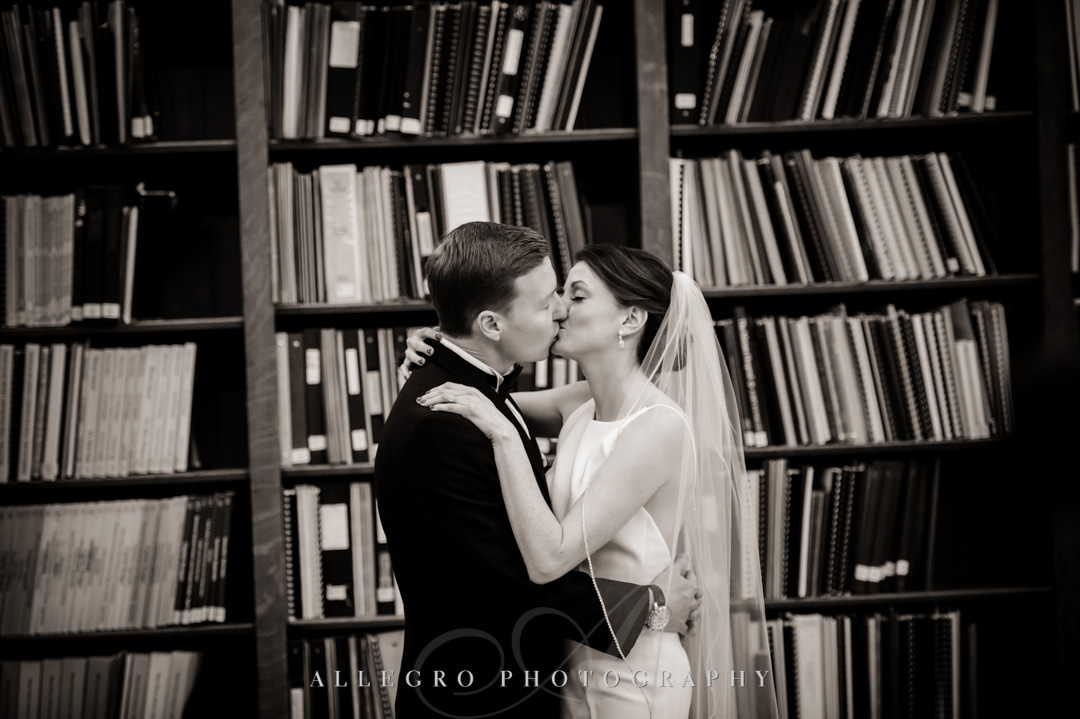 providence ri state house - Bride and groom kiss in library stacks