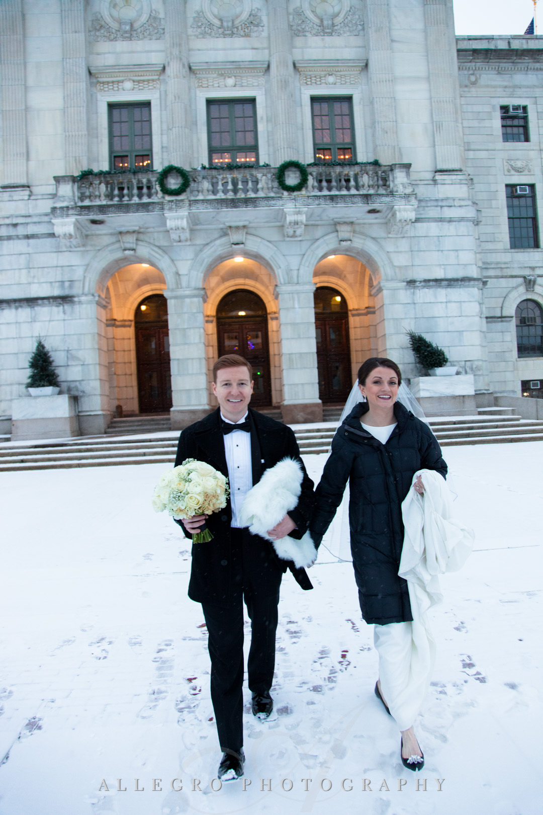 providence rhode island state house- Bride and groom walk in snowy Providence, RI