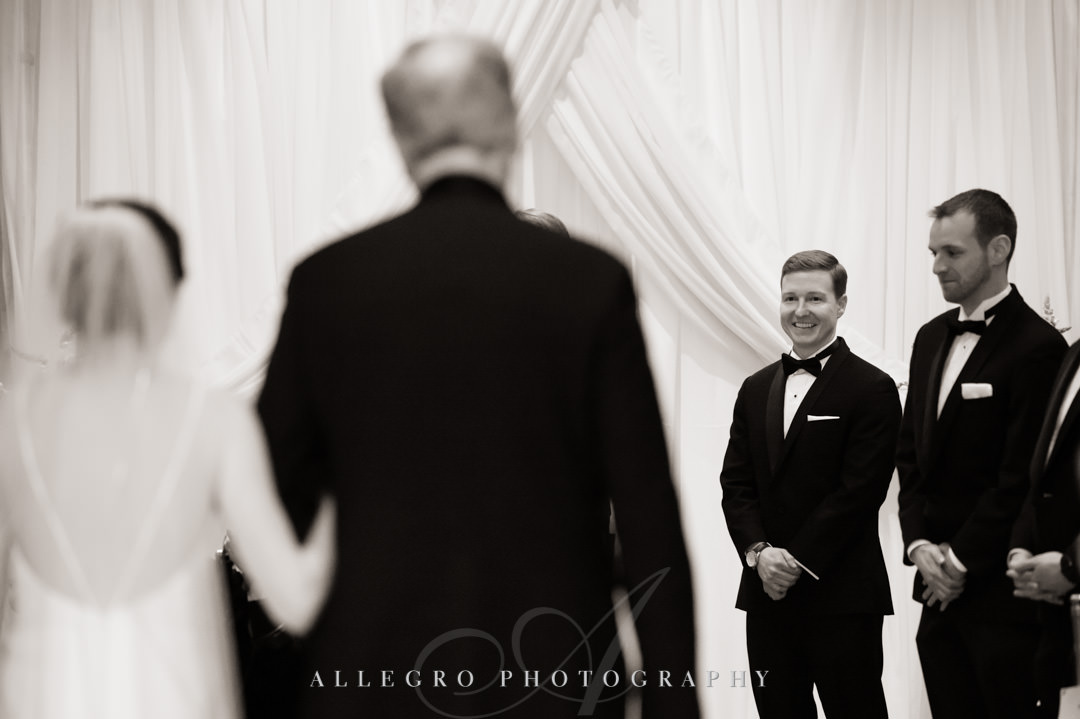 Groom awaits his bride at the alter