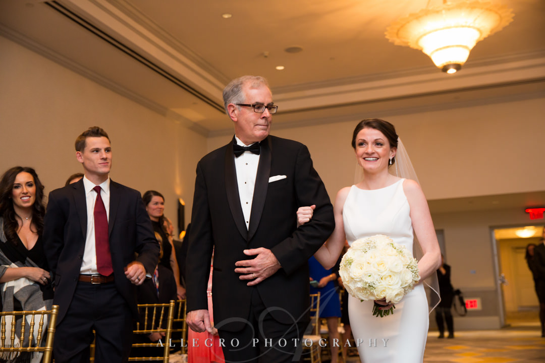 Bride is walked down the aisle by her father