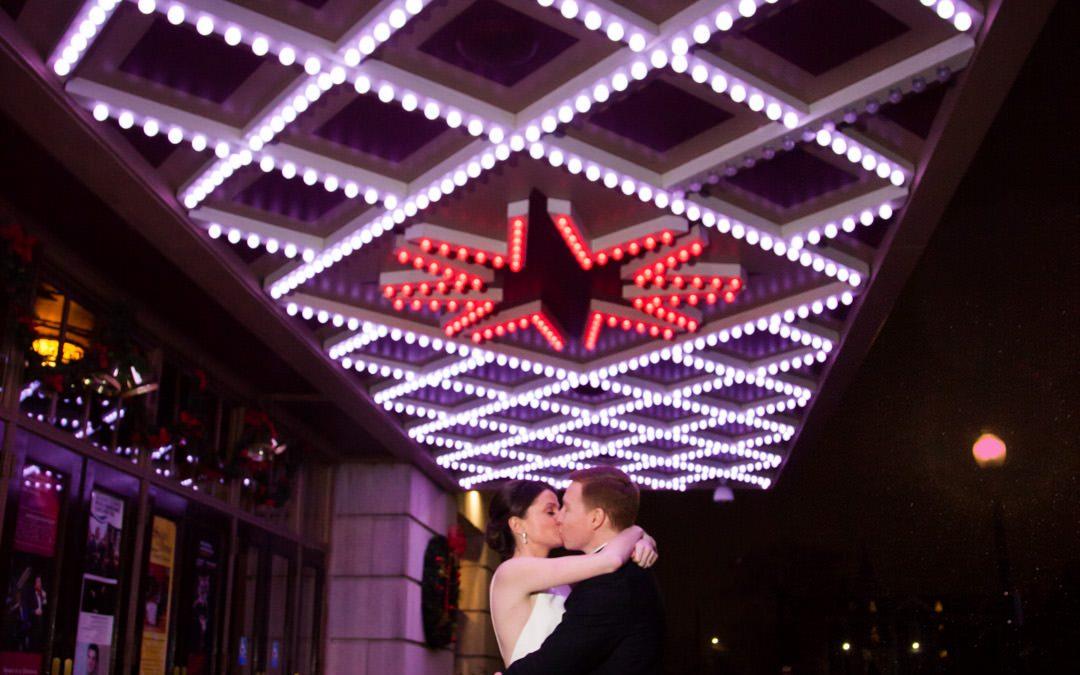 Bride and Groom dance under light design ceiling