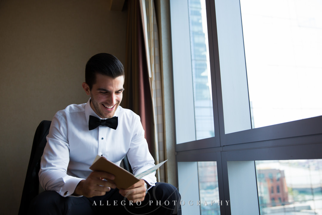 Groom reads card from bride