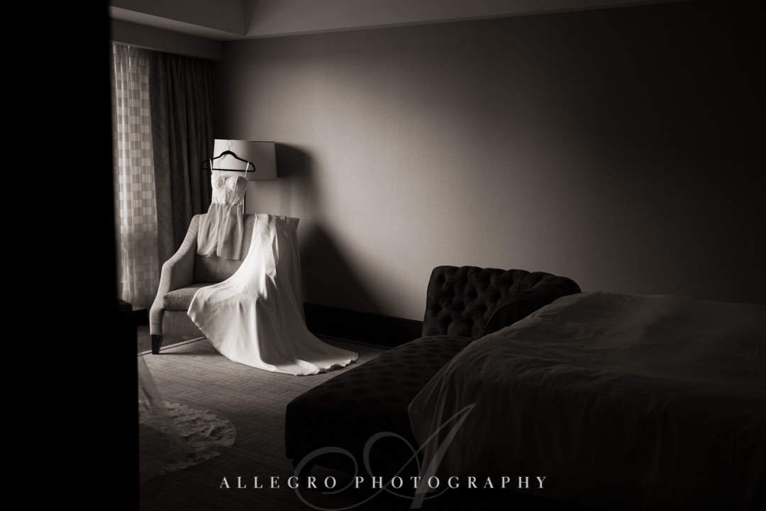 Wedding dress draped over a chair