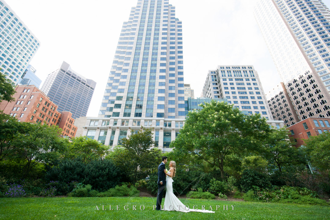 Bride and groom pose in front of state room building in Boston