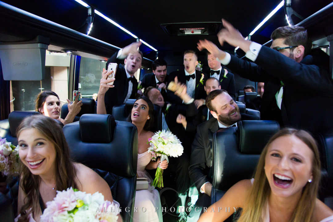 Wedding party dancing in bus on way to wedding