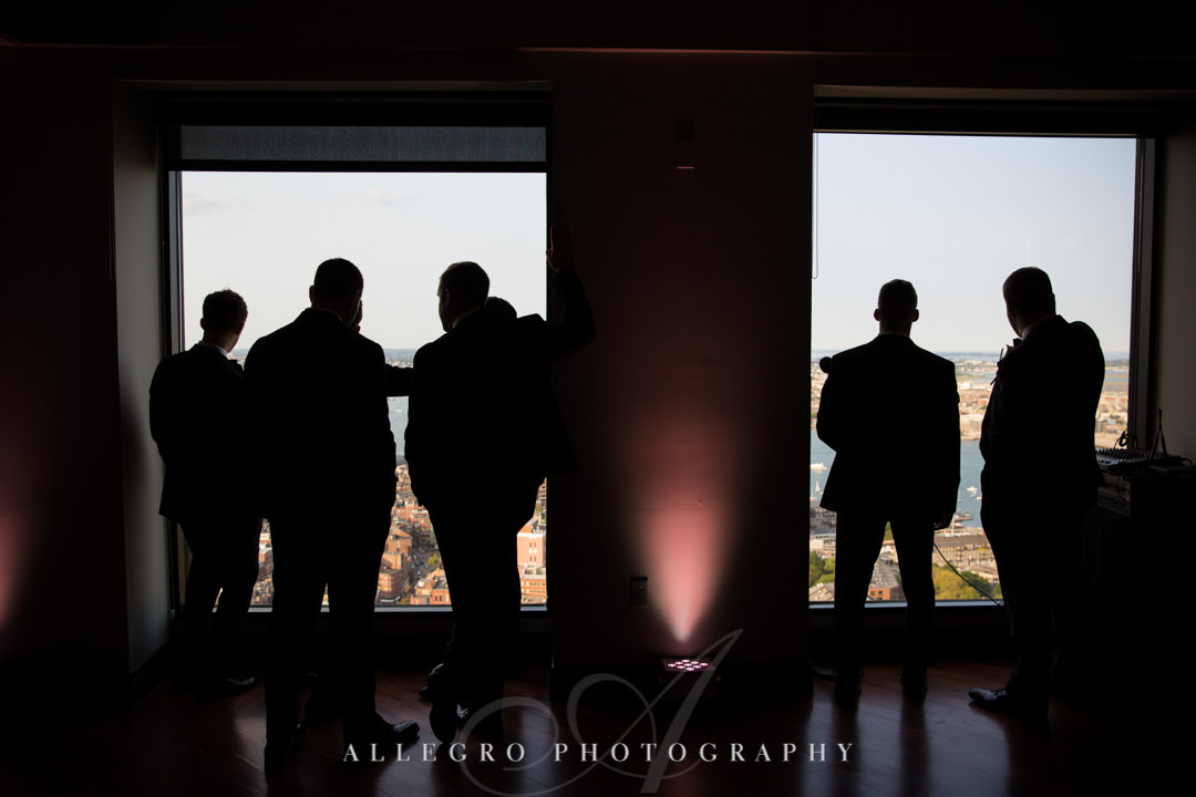Groomsmen stare out at view of Boston