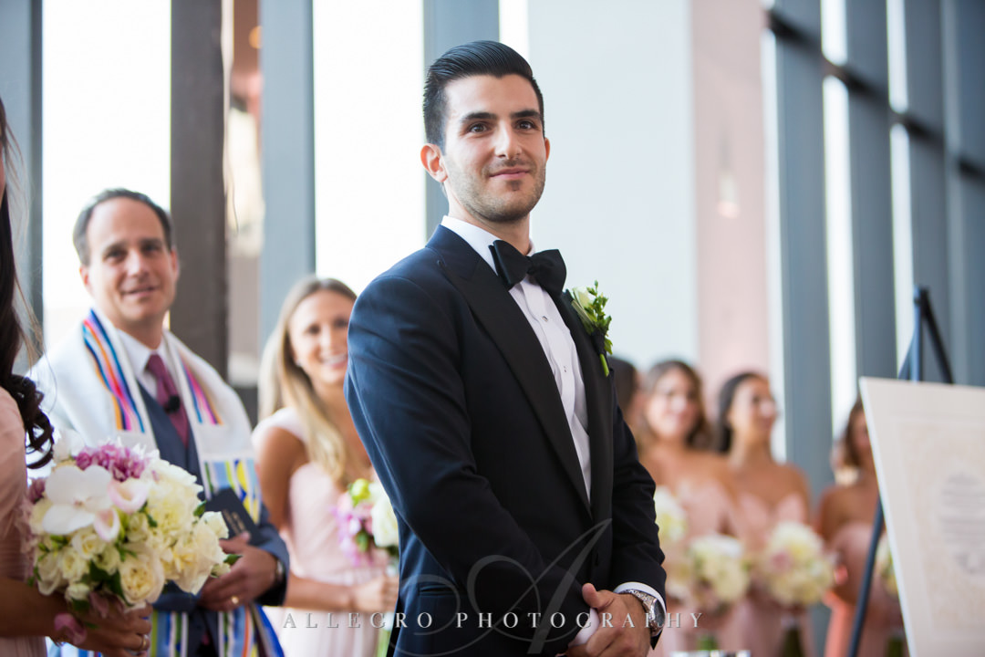 Groom awaits his bride at alter