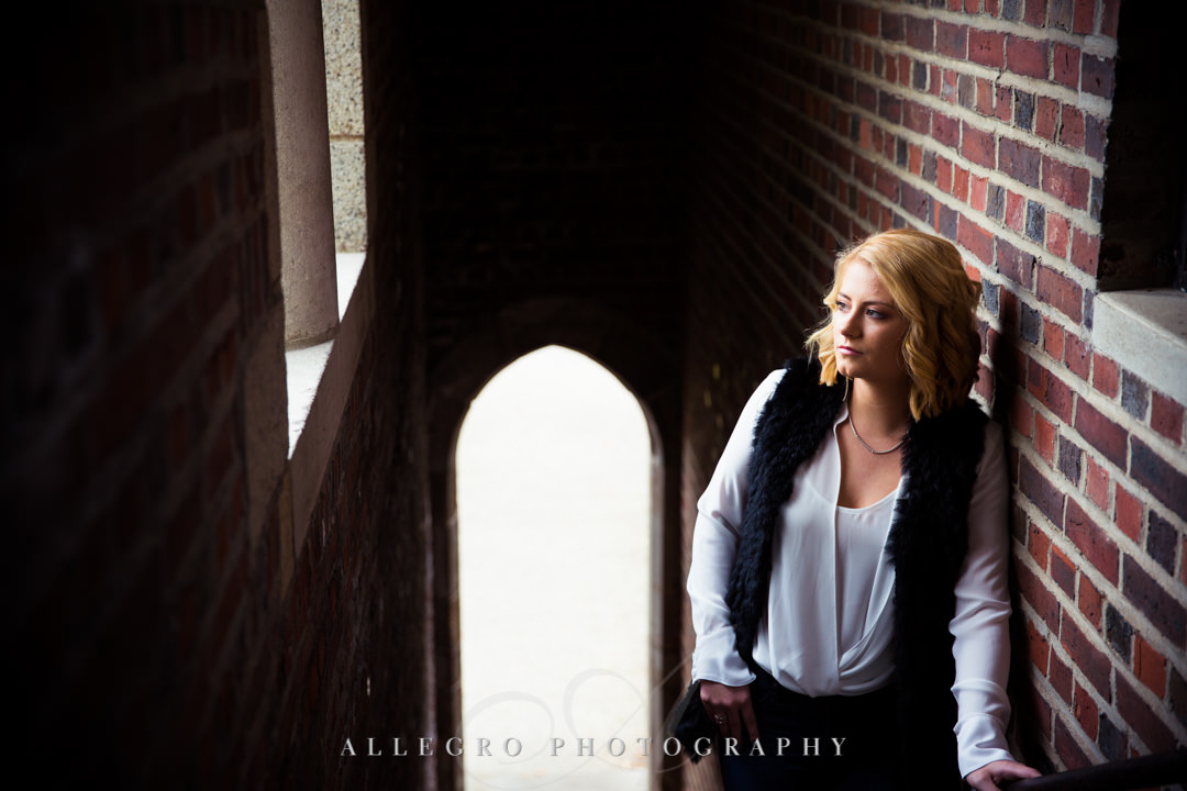 Blonde teenager in brick stairwell