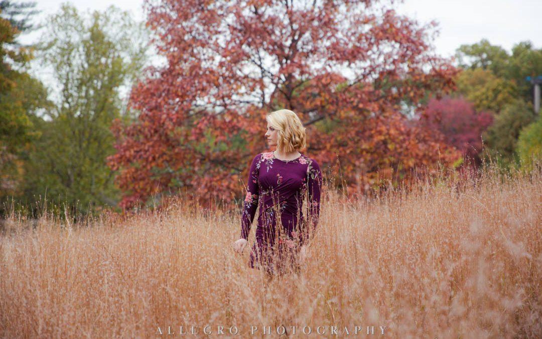 High school girl posing in a field at Wellesley College