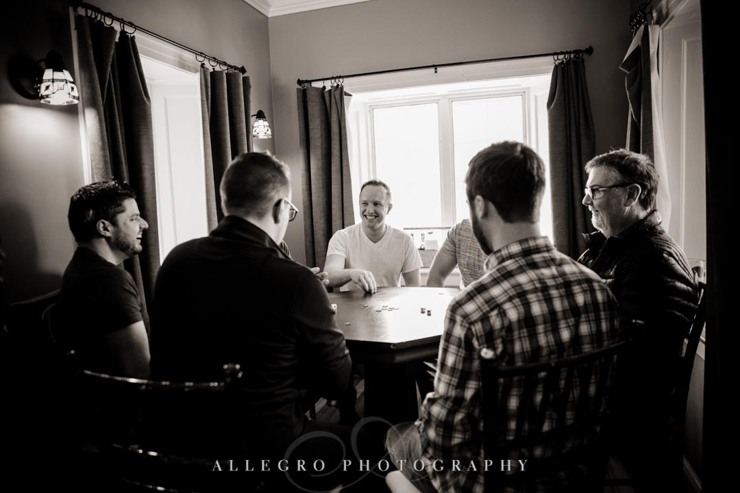 Groomsmen play poker with groom