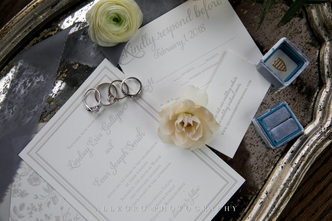 Wedding invitations, flowers, and wedding bands