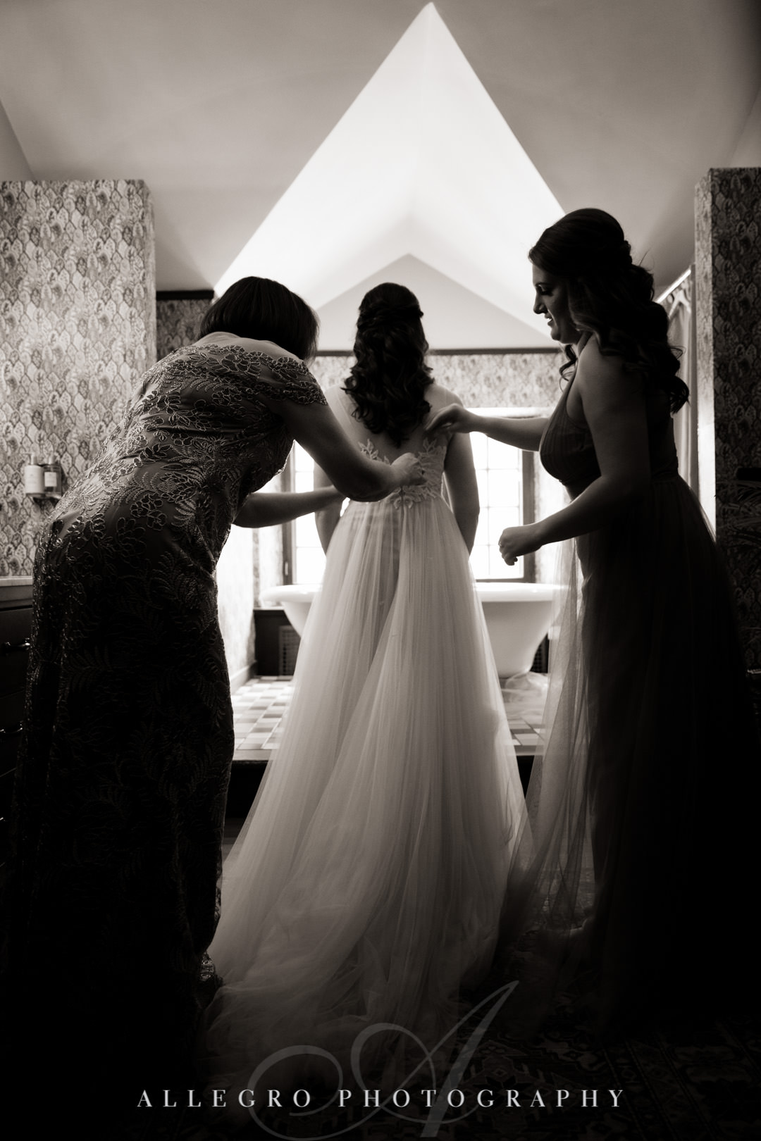 Bridesmaids help bride with her veil