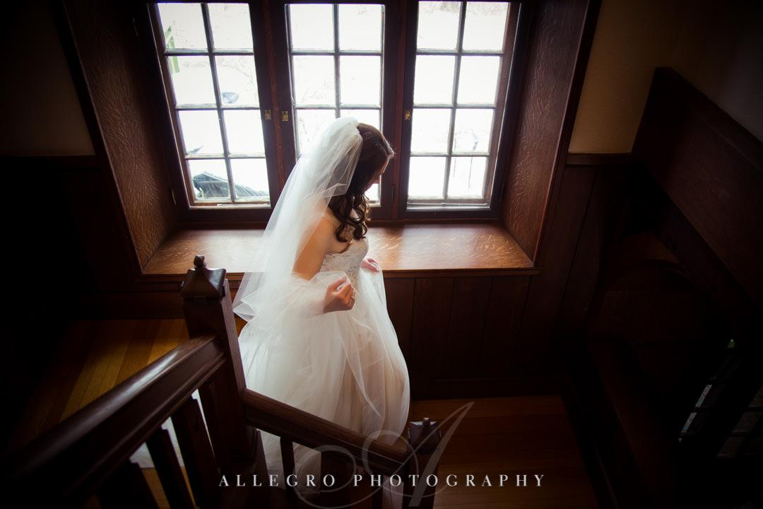 Bride walks down stairs