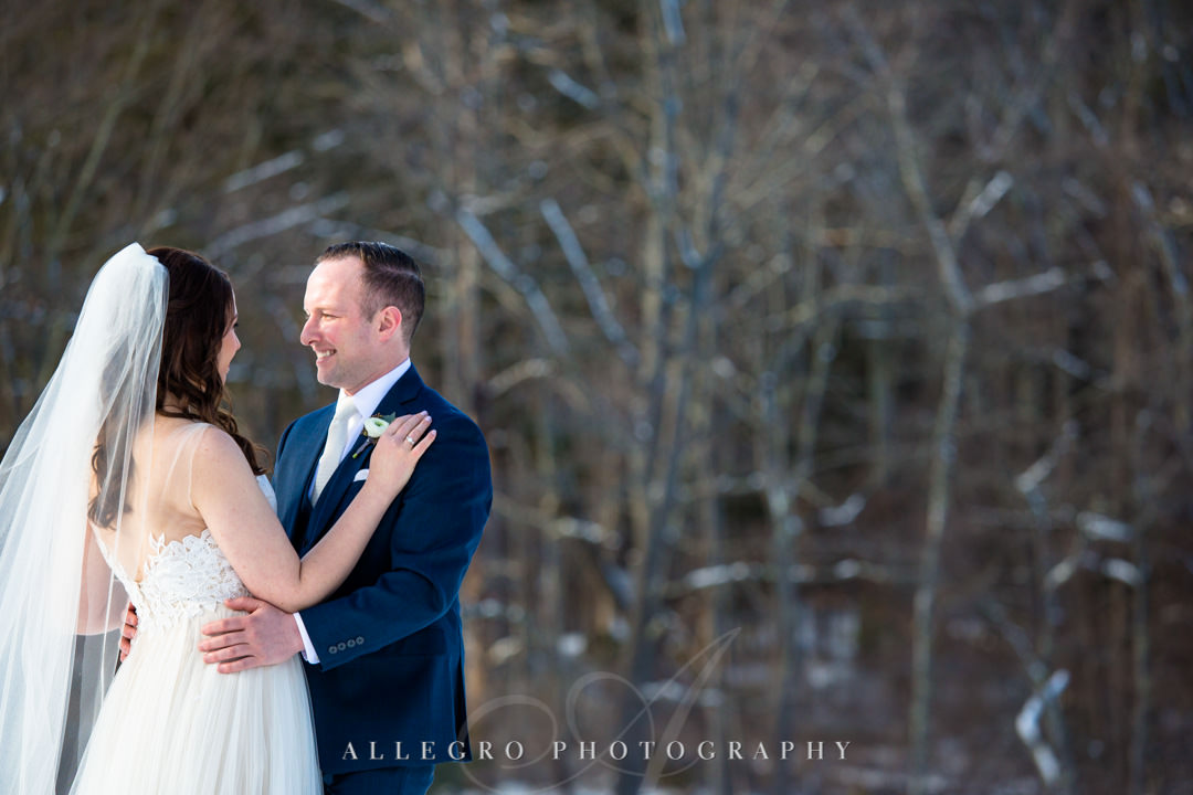 Bride and groom stare lovingly at each other on a winter wedding day