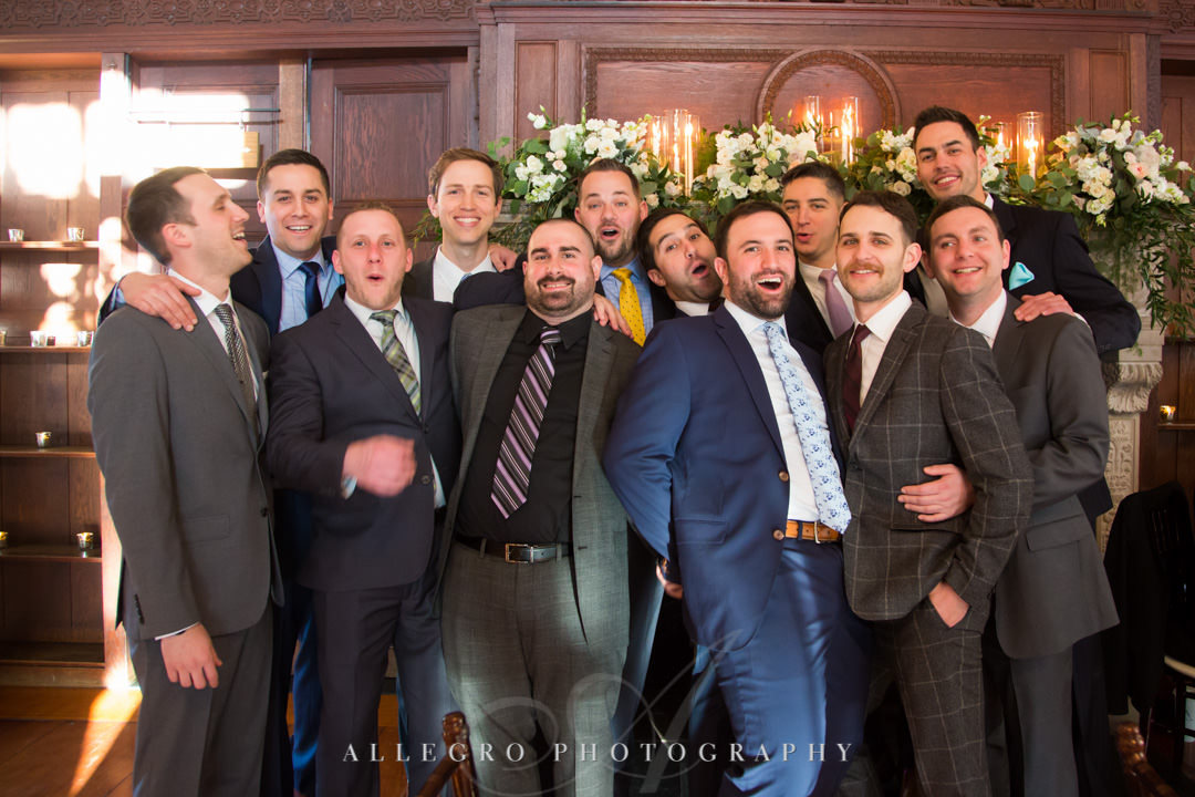 Men attending wedding pose for silly picture