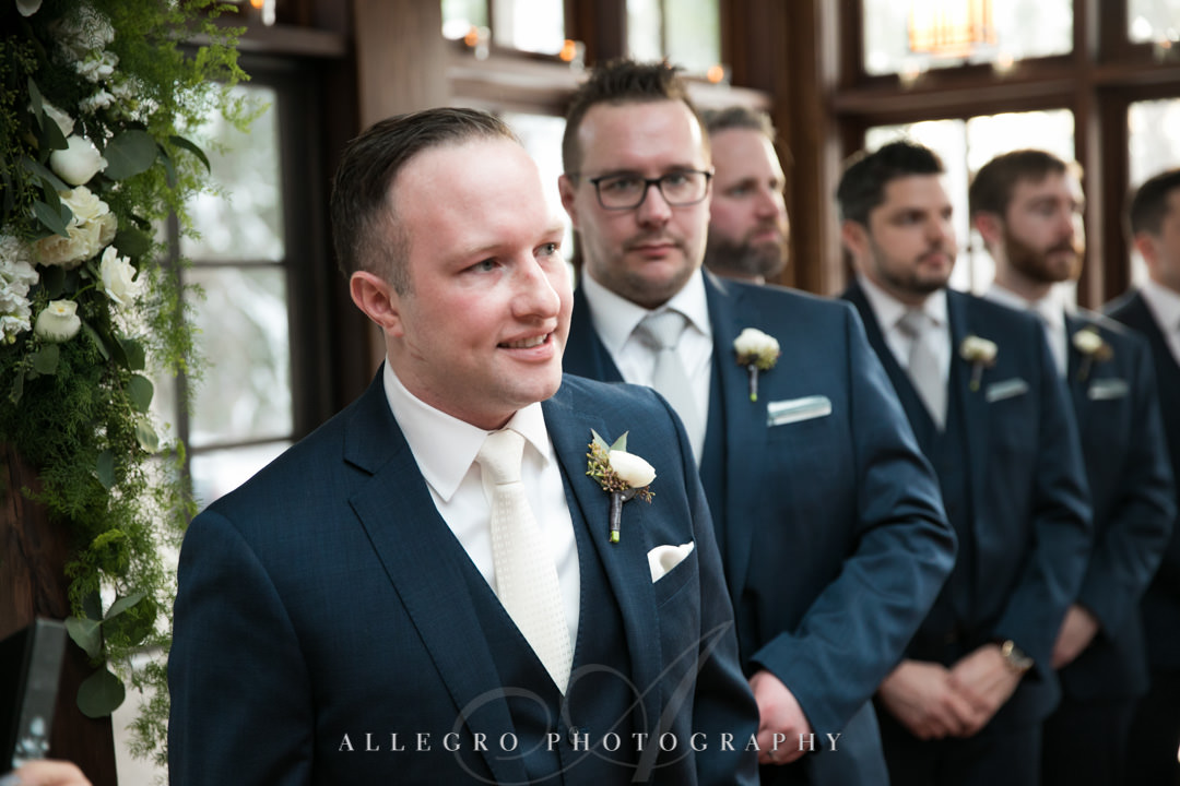 Groom anxiously awaits for bride at the alter