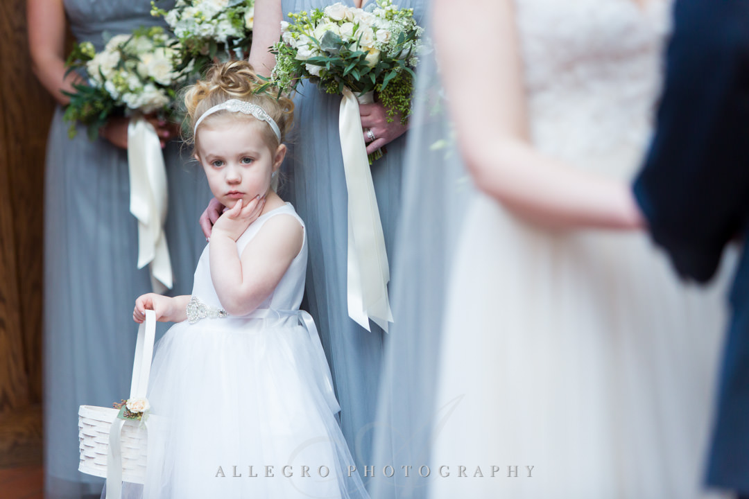 Flower girl watches bride and groom