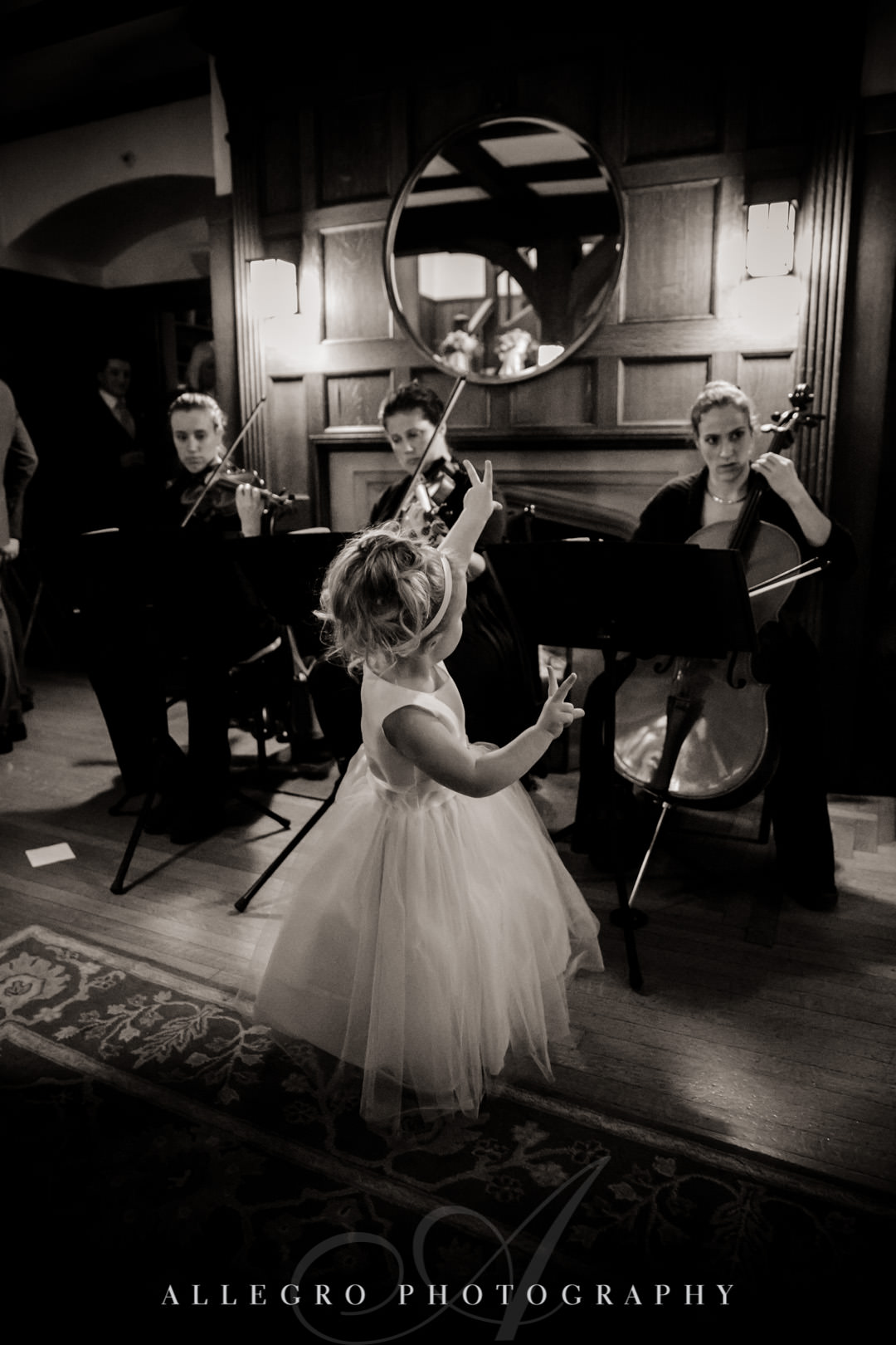 Flower girl dances with Arreaux Strings band
