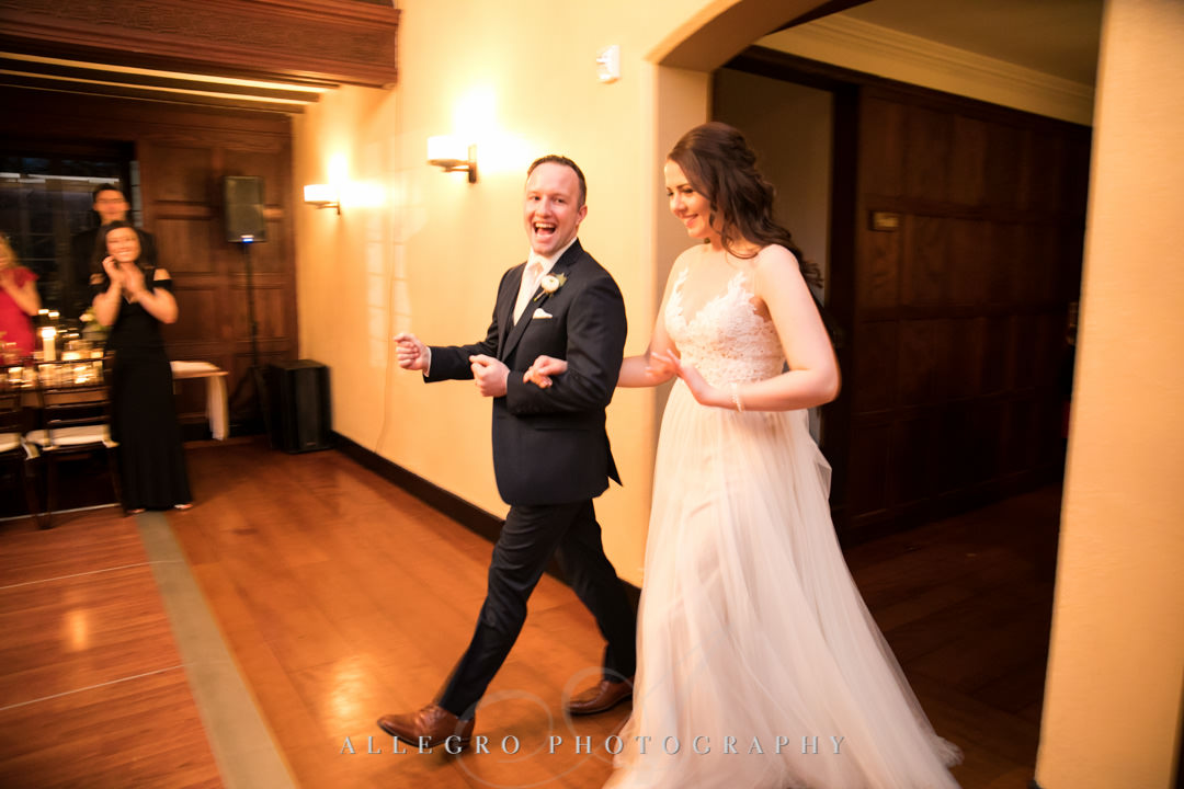 Bride and groom enters reception room together