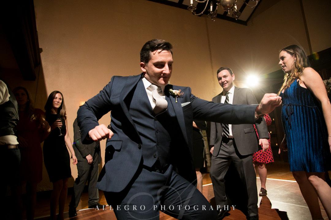 Groomsman dances wildly at wedding
