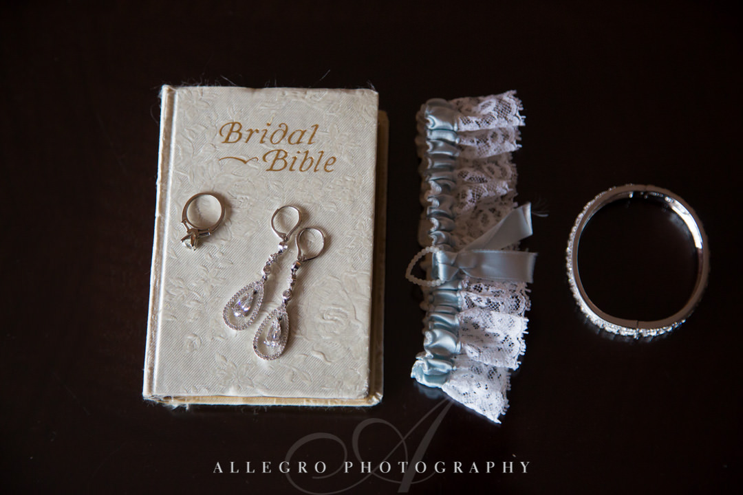 "Wedding jewelry atop ""Bridal Bible"" 