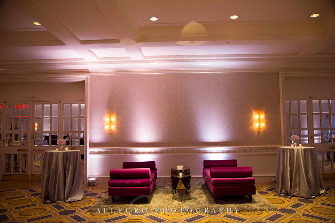Pink toned lobby of wedding reception | Allegro Photography