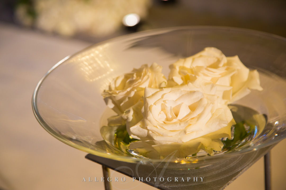 Flowers sitting in martini glass | Allegro Photography