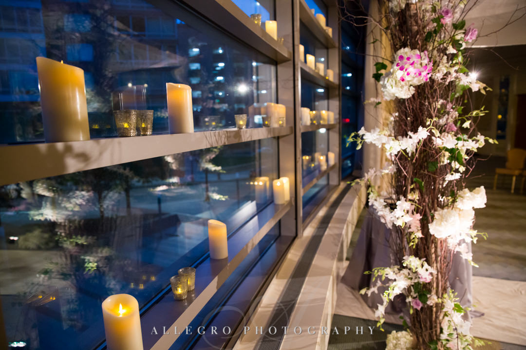 Candles lining windowsill at wedding | Allegro Photography