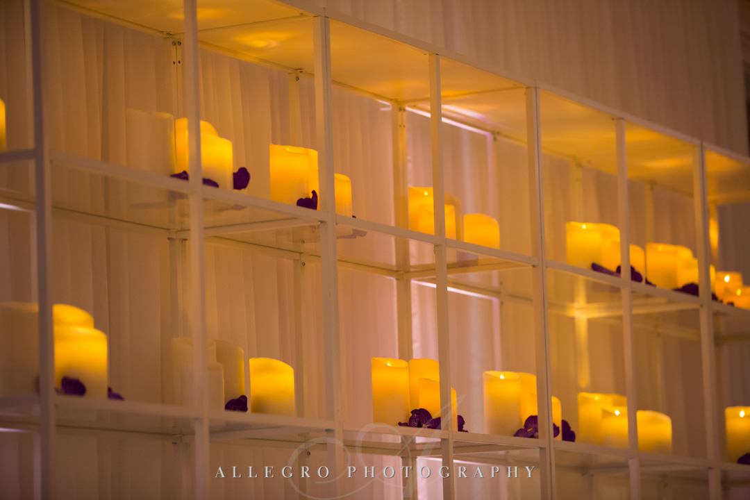 Candles lining shelves | Allegro Photography