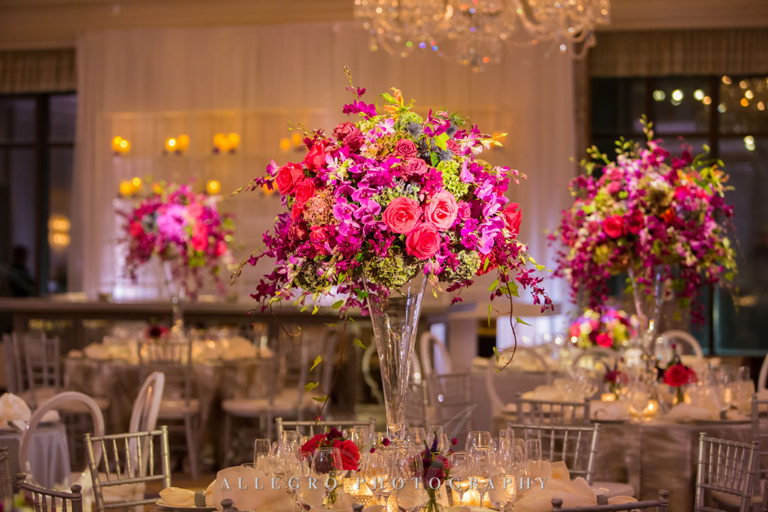 Neon pink flower centerpiece | Allegro Photography