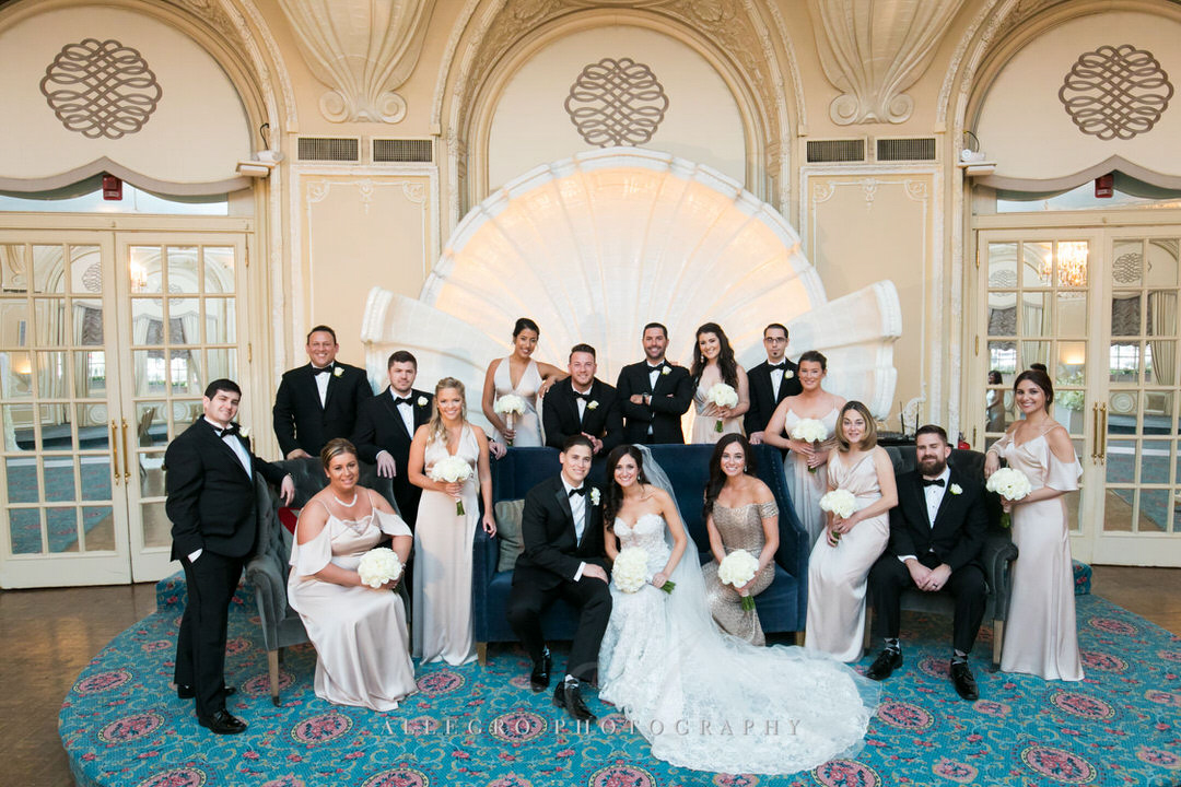 big family portrait with bride and groom