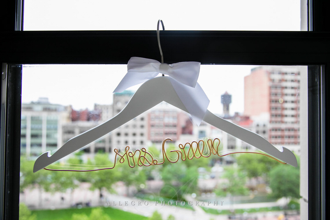 hanger for the dress says last name of couple