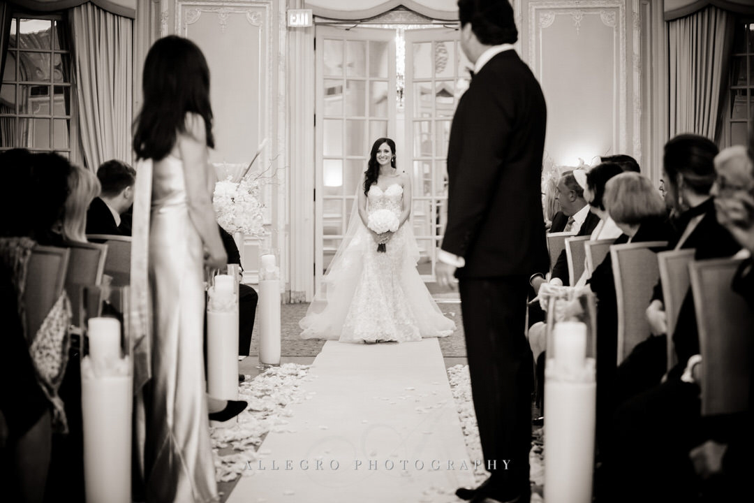 bride begins to walk down the aisle