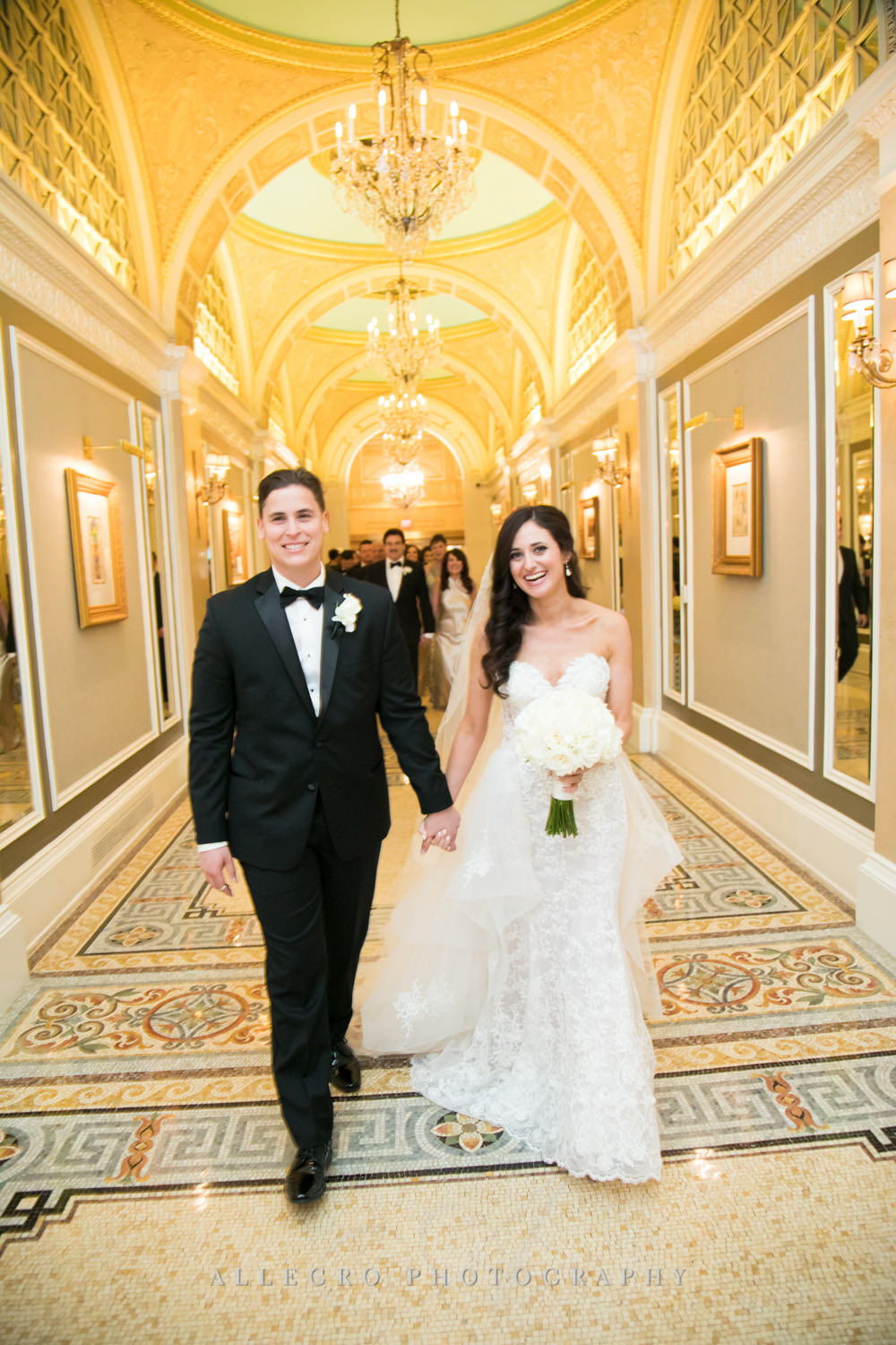 bride and groom smile as they walk out of ceremony