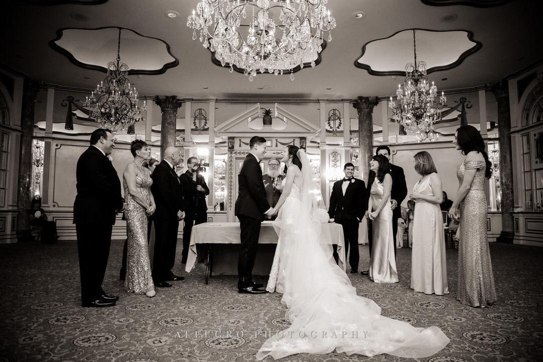bride and groom hold hands after ketubah is signed