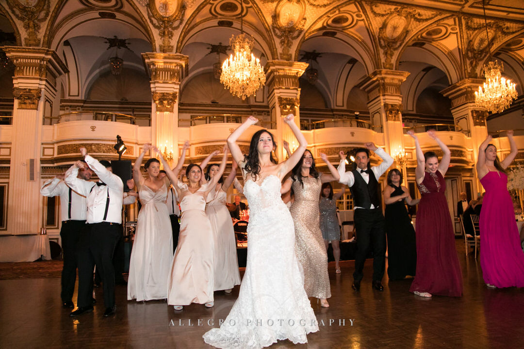 bride dances while guests cheer her on