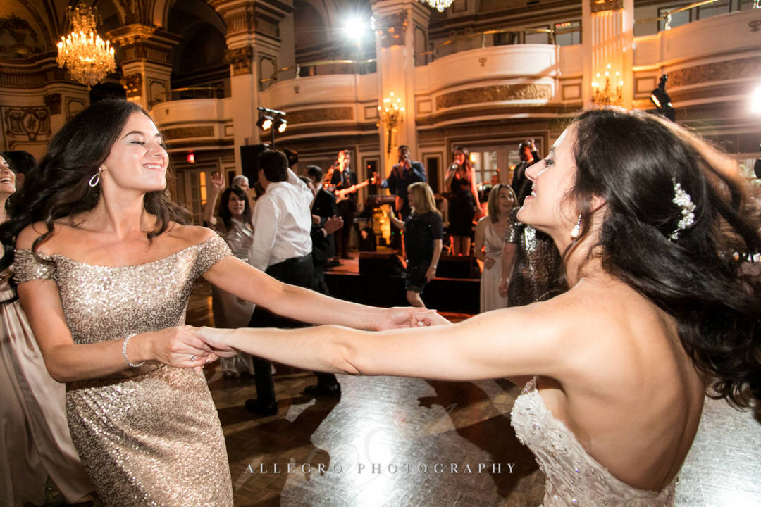bride and maid of honor dancing together