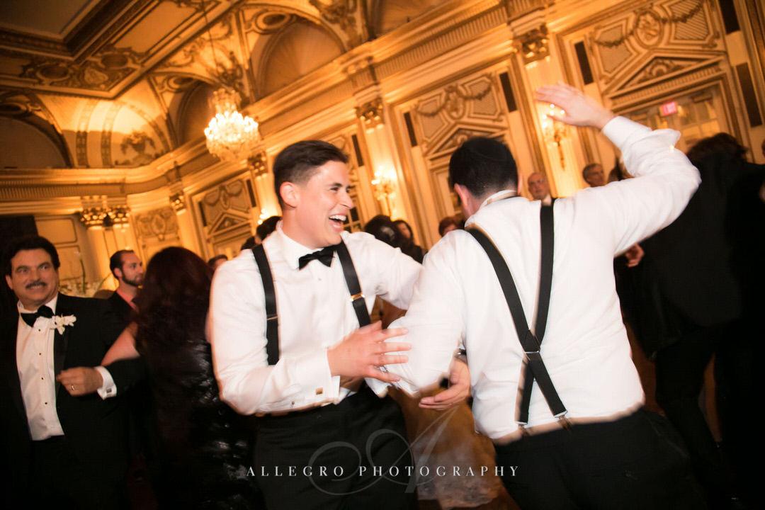 groom dances with groomsman