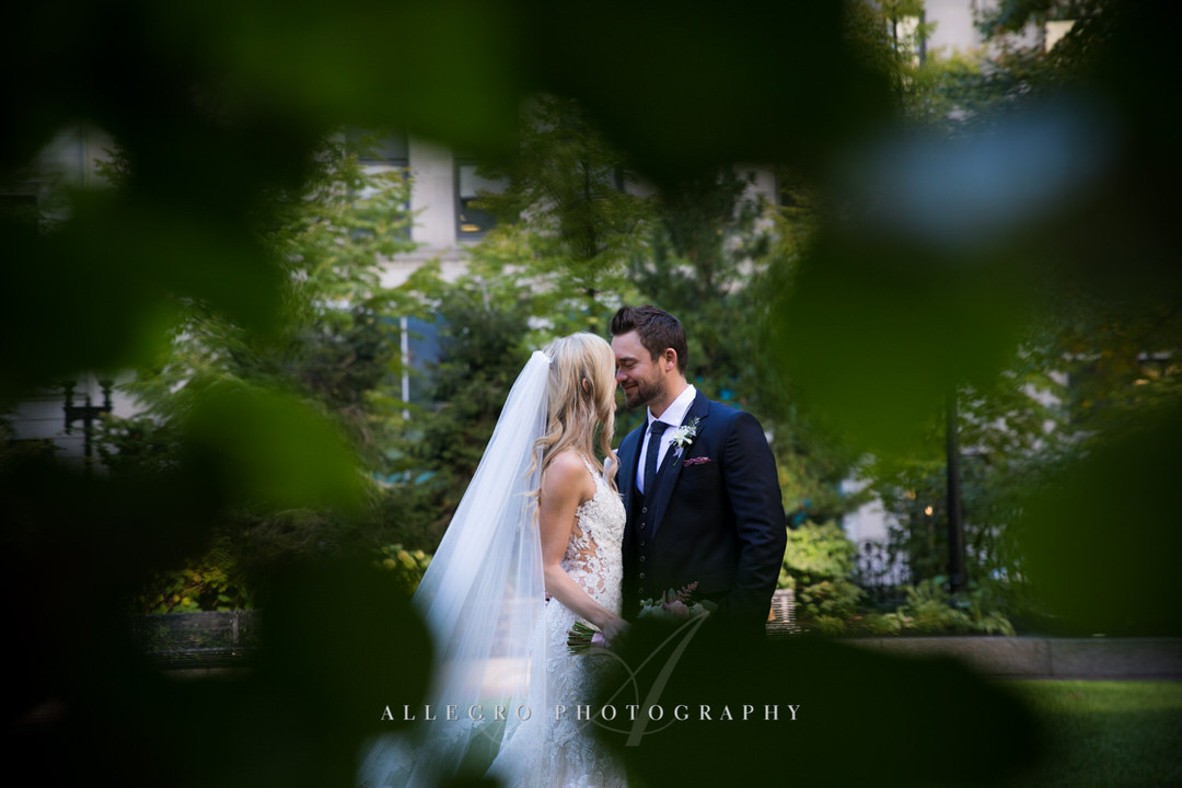 bride and groom kiss in post office square