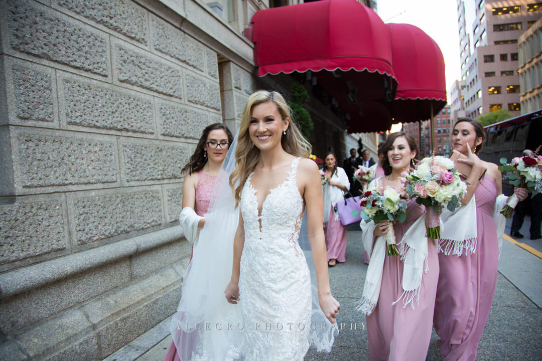 Bride walking with her bridesmaids