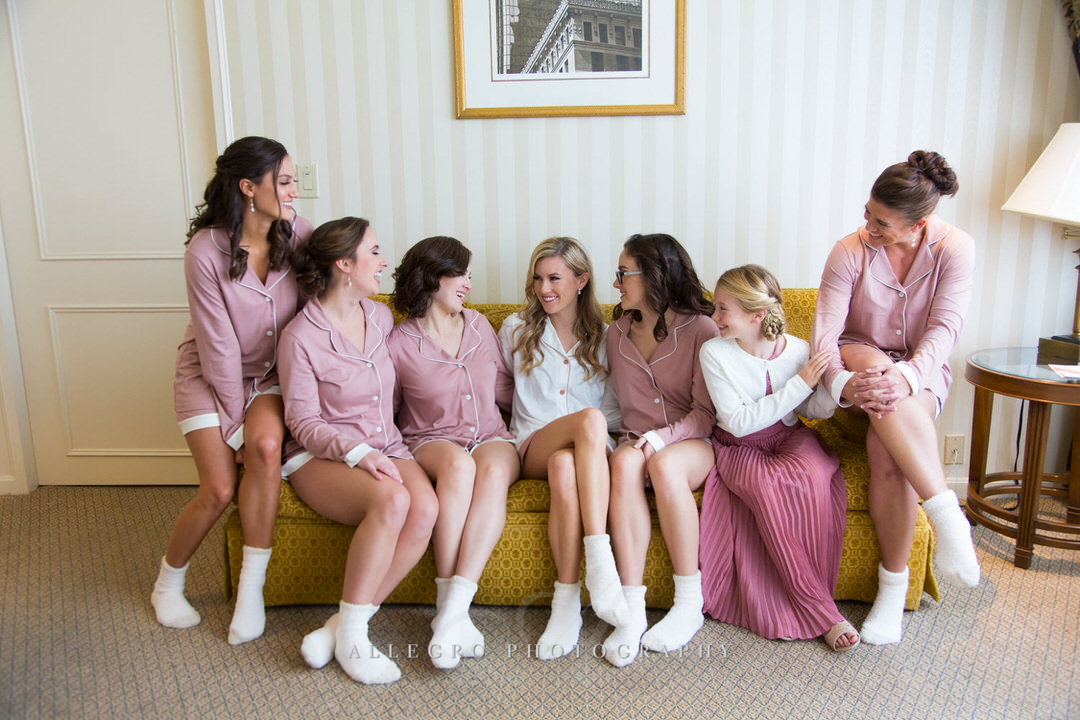 Bride and Bridesmaids share laughs while getting ready