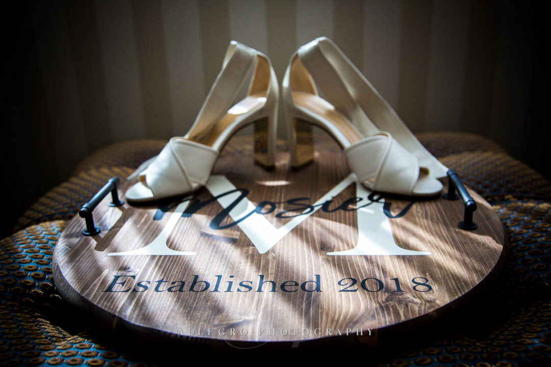 brides heels with name board