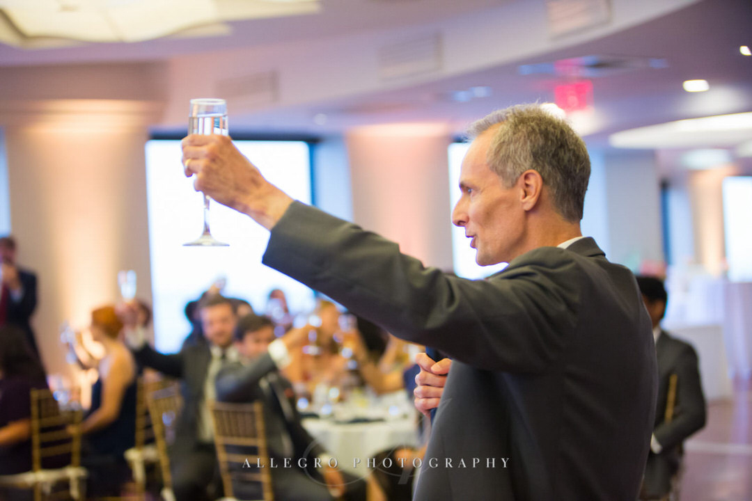 father of the bride cheers after his toast