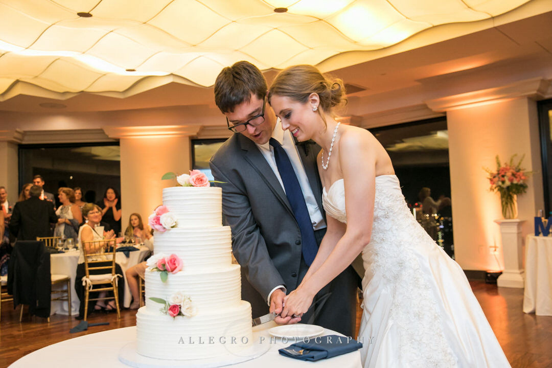 bride and groom cut the cake together